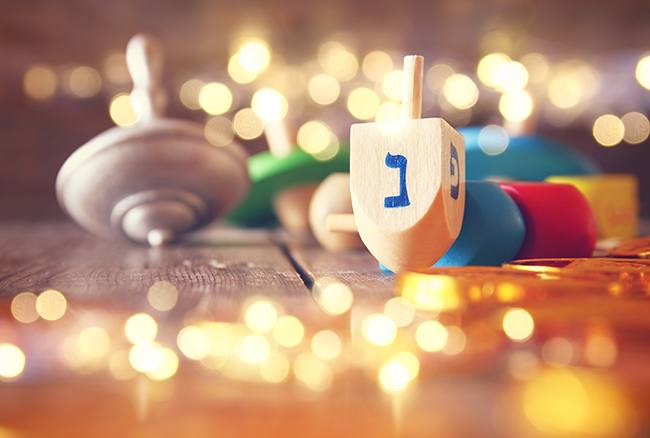 Hanukkah with wooden dreidels