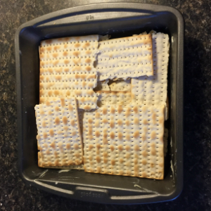 Matzah layered in the baking dish