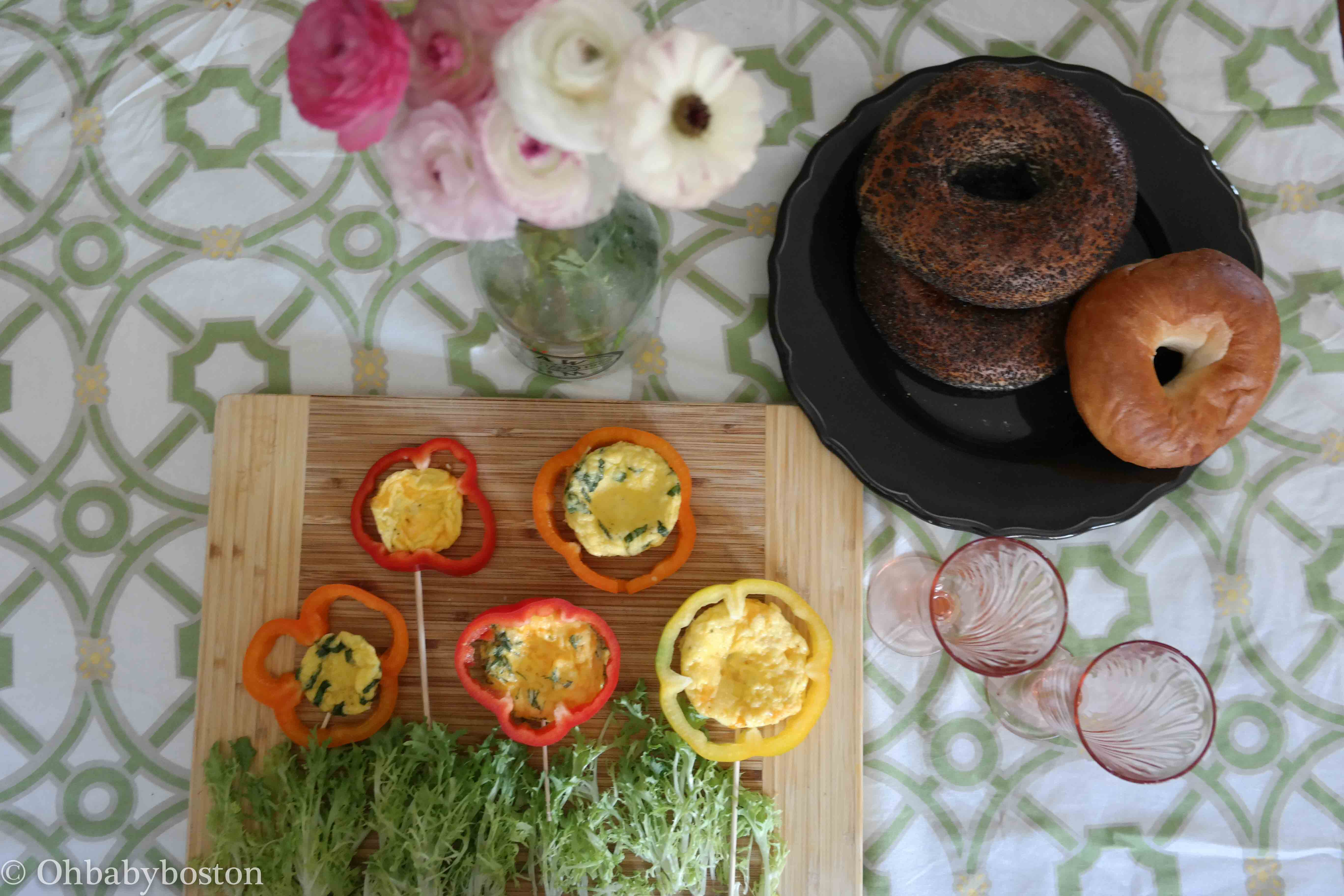 Frittata Flowers on cutting board with plate of bagels