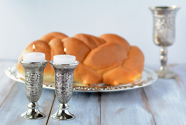 Shabbat candles with challah and wine