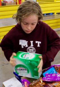 My son helping to pack snack boxes at the North Texas Food Bank in January.