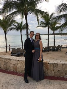 photo of couple in formal wear with the beach and palm trees in the background