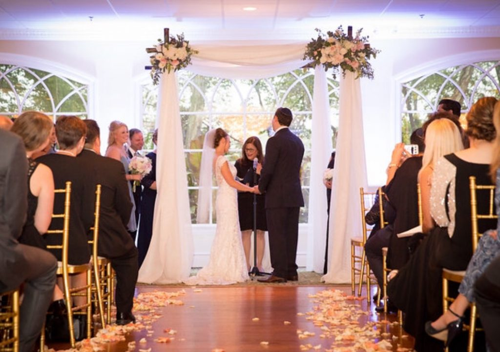 Under the Chuppah during our Interfaith wedding ceremony