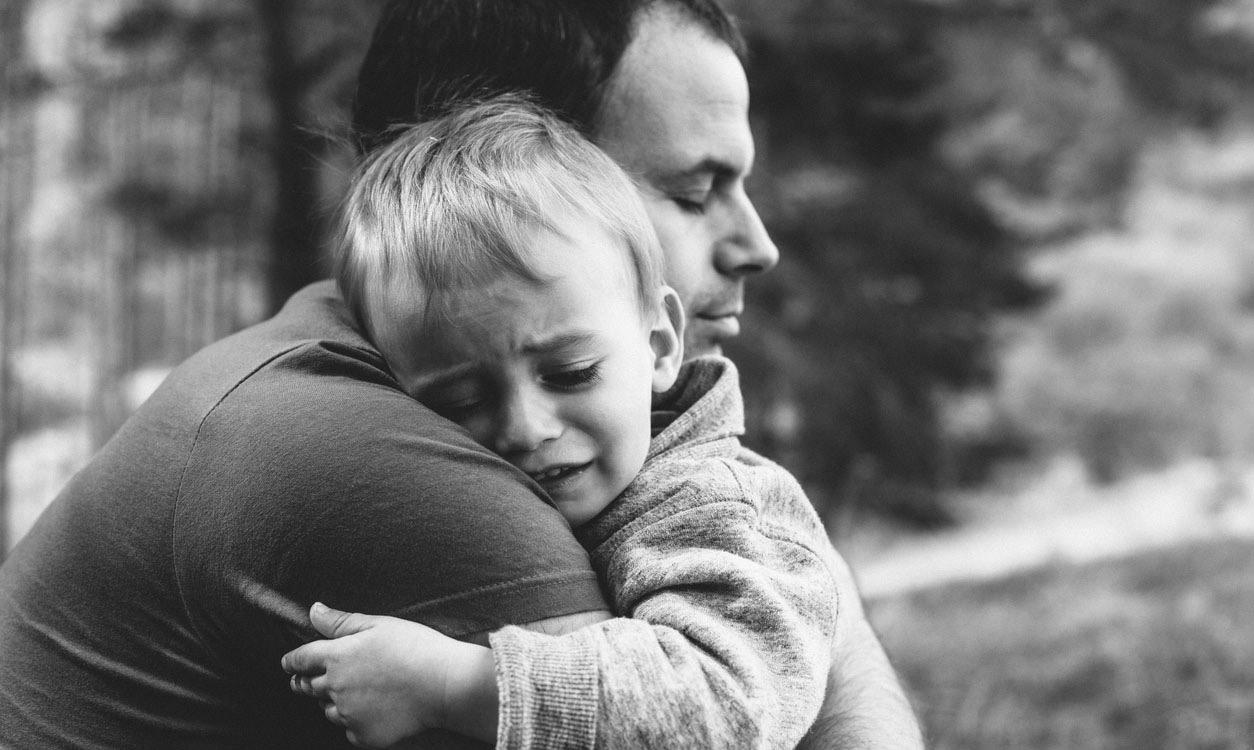 Dad hugging child
