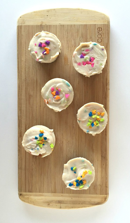Cheesecake bites on wooden cutting board