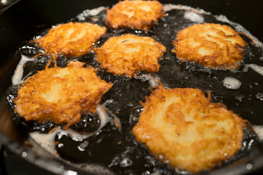 Latkes frying in a pan