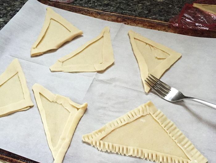 make triangles of dough