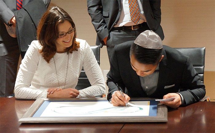Jose signing the ketubah