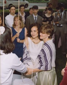 Mychal under chuppah with her wife on their wedding day.