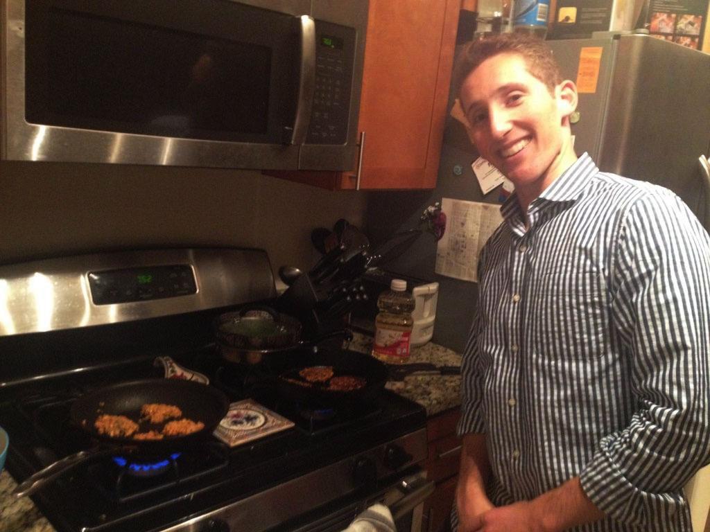 Zach cooking latkes