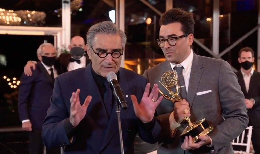 Eugene and Daniel Levy celebrate their Emmy win