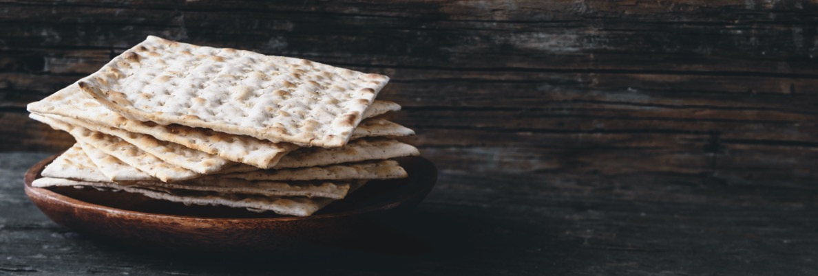 A stack of Matzah crackers on a table.