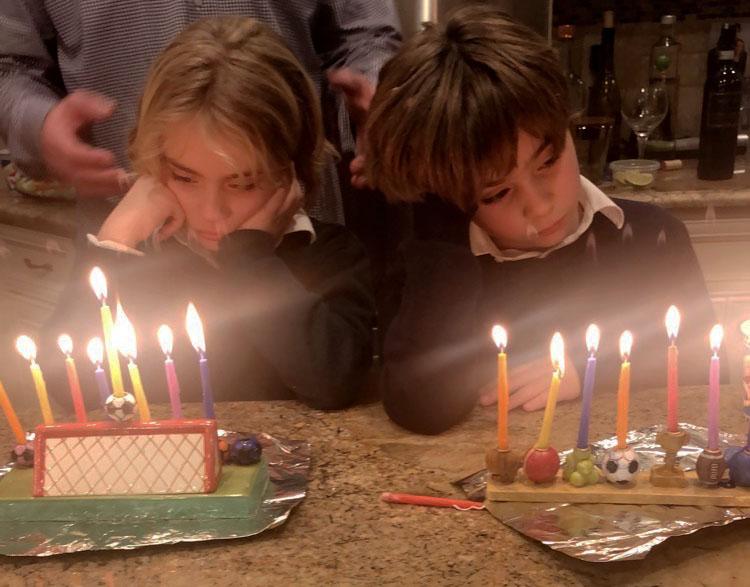 Jodi's kids celebrating Hanukkah