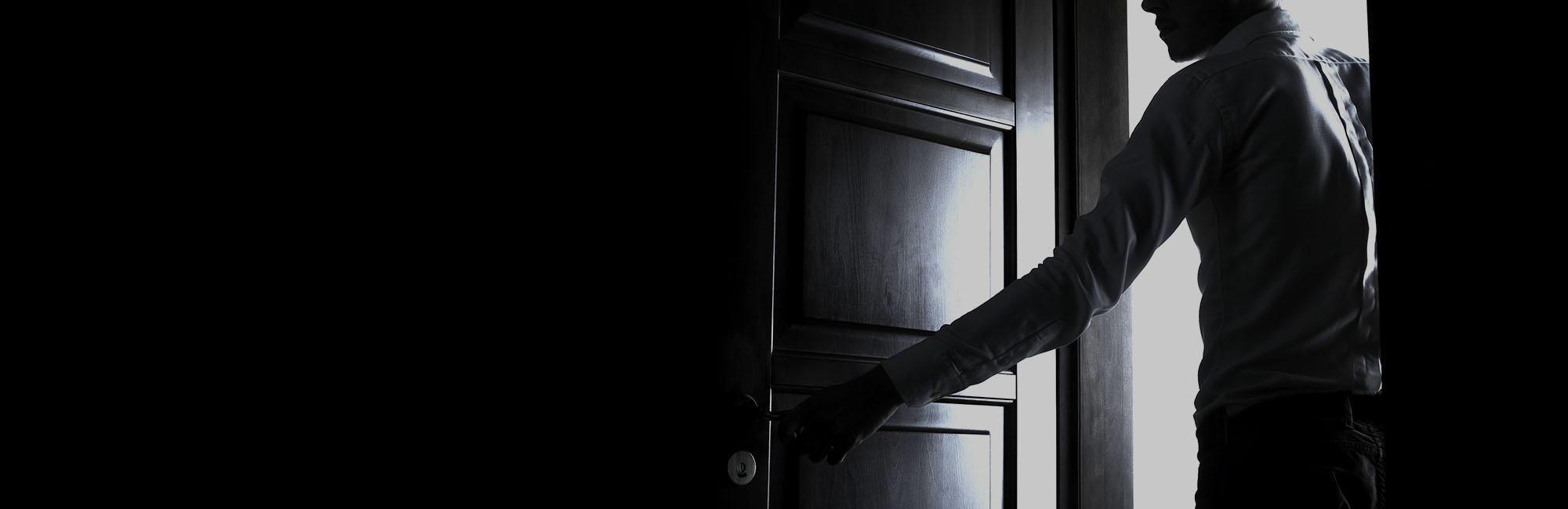 man opens door
