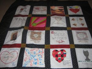 Image of a brightly colored quilt laying flat.